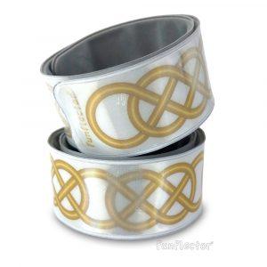 Keltisch Gold Snap Reflektorband. Gut geeignet für Radfahrer, Jogger und Fußgänger, besonders die, die alles Irische und Keltische lieben. Sicherheitsreflektoren können bequem an Armen und Beinen getragen werden.