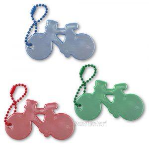 Farbenfrohe Fahrrad Reflektor-Anhänger. Diese Sicherheitsreflektoren sind für Fahrradfahrer genauso geeignet wie für Fußgänger und können bequem an Reißverschlüssen, Taschen oder Rucksäcken befestigt werden.