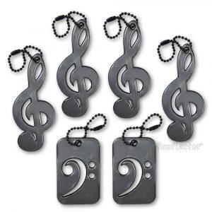 Notenschlüssel Reflektor-Anhänger für Musiker und Musikliebhaber. Musikkollektion enthält zwei Basschlüssel und vier Violinschlüssel. Leicht an Notentaschen, Instrumentenkoffern und Jacken zu befestigen.