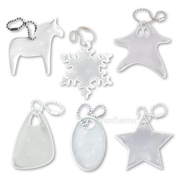 Dezente und elegante weiße Reflektor-Anhänger für Fußgänger beim Spazierengehen oder Bummeln. Motive Dalapferd, Schneeflocke, Gespenst, Dreieck, Oval und Stern